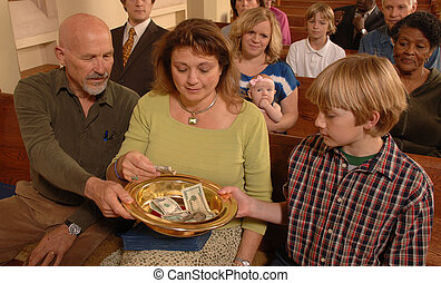 Tithing - A Sunday morning church congregation putting money...