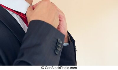 business man straightens a red tie. 4k, slow-motion, super...