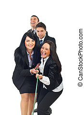 Laughing businesspeople playing tug of war - Laughing four...