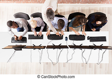 Elevated View Of Students Using Computer - Elevated View Of...