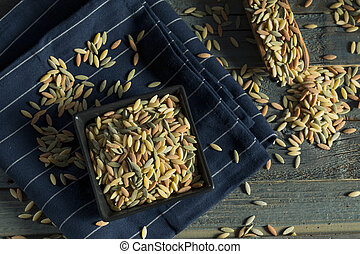 Dry Organic Tricolor Orzo Pasta in a Bowl