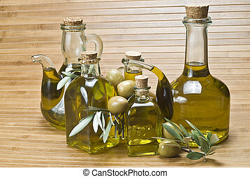 Bottles of olive oil and olives 5 - Some bottles with olive...