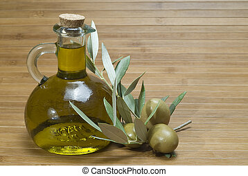 Bottles with olive oil and olives 6 - Some bottles with...
