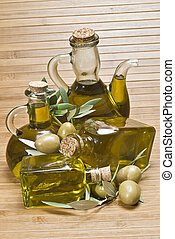 Bottles with olive oil and olives 3 - Some bottles with...