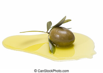 Green olive on some olive oil - One green olive with leaves...