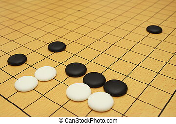 Go game board with black and white stones