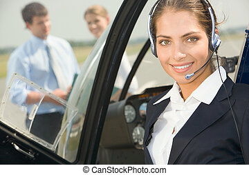 Commercial pilot - Confident pilot with headset smiling in...