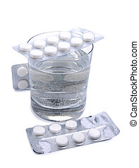 Pills and glass four - Medical pills and glass whit water on...