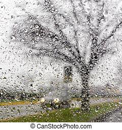 Inside the car when raining - Blurry car silhouette seen...