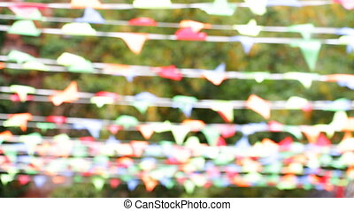 Small flags swaying in the wind - Multicolored festive small...