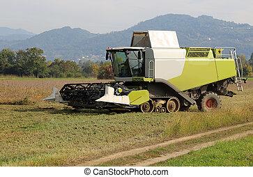 huge Combine harvesting during cereal harvesting - big...
