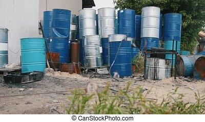 A lot of barrels with gasoline and engine oil - ecology concept