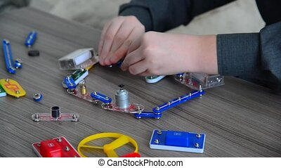 Child conducts physical experiments with light and movement...