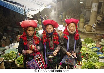 Hmong red pompons women - Red pompons Dao ethnic female in...
