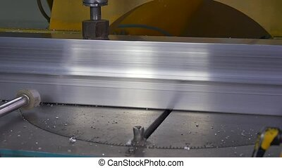 Cutting metal with circular saw on automated machine by...