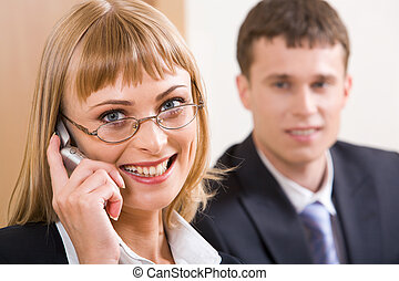Calling by the phone - Portrait of smiling blond business...