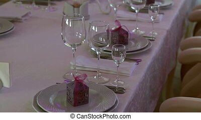 Cymbals and wine glasses on the wedding table.