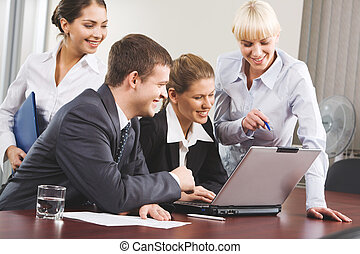 Collaboration - Business woman demonstrating correct way of...
