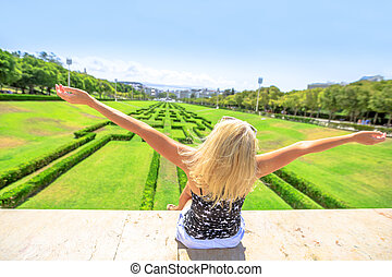 Park Eduardo VII Lisbon - Happy tourist woman with open arms...