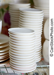 Set of white dishes isolated on white.Stack of plates