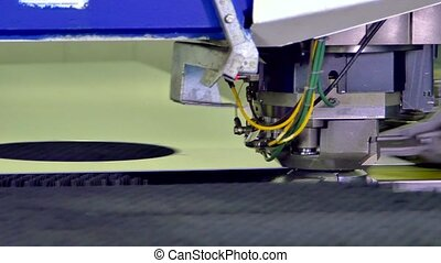 Figured curly metal cutting on automated machine by robot....