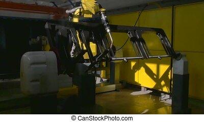 Metal iron laser argon welding robot in factory. Industrial...