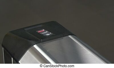 Hands of people apply electronic pass to turnstile wicket...