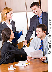 Business agreement - Business people shaking hands in the...
