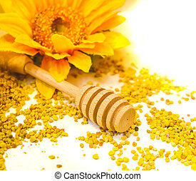 propolis granules honey dripper background drizzle wooden spoon