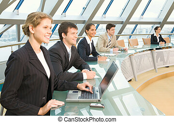 Shareholders meeting - Businesspeople sitting at the round...