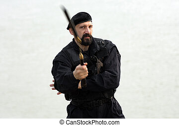 security man with nunchaku - The security man in uniform is...