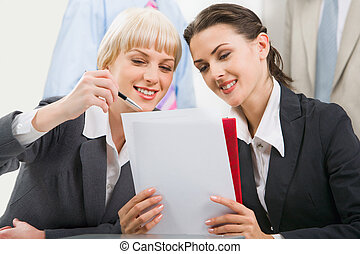 Teamwork - Business woman demonstrating a new plan to her...