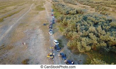 Column of auto tourists. Aerial survey - The column of auto...