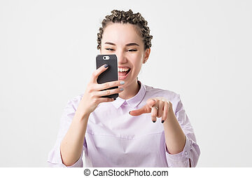 Caucasian woman spending free time using a smart phone....
