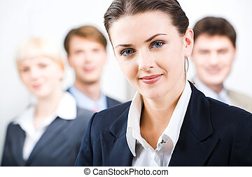 Leader - Photo of leader with her business team in the...
