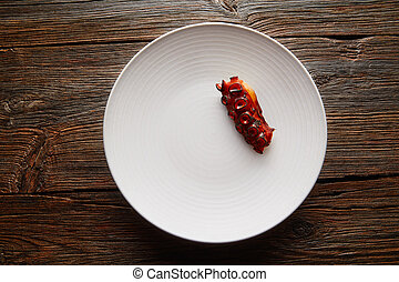 Grilled octopus modern cuisine gastronomy on white plate
