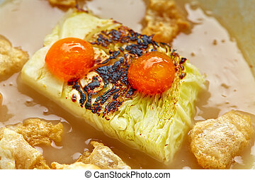 Cabbage stew with pork rinds recipe