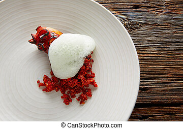 Grilled octopus with parsley air foam served with crunchy...
