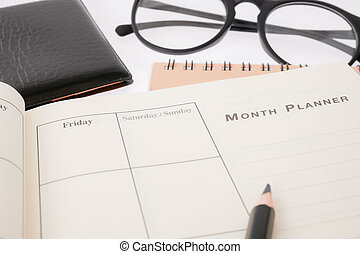 blank planning notebook and pen on desk use us organizer schedule life or business planner concept