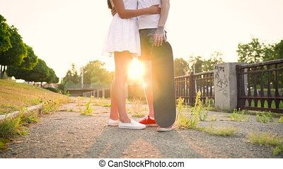 Young couple in love kissing on the street at sunset - Young...