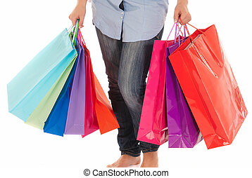Unrecognizable woman with shopping bags isolated on white background