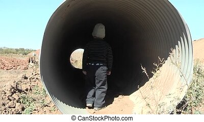boy - small boy is interested by pipe