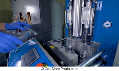 Heavy but compact machinery for PET bottle production. - An...