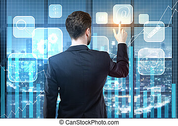 Analytics concept - Back view of young businessman using...