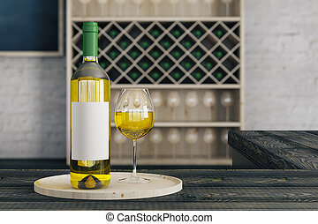 Drink concept - Close up of white wine glass and bottle with...