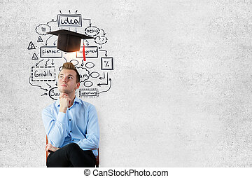 Graduation concept - Thoughtful young businessman sitting on...