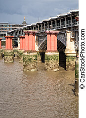 Red pillars in the River Thames between Blackfriars road...