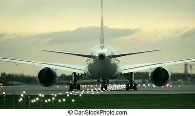 Twin engine commercial airplane starting takeoff from the...