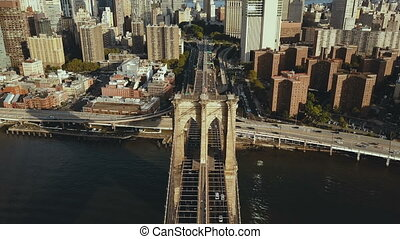 Top aerial view of the Brooklyn bridge through the East...