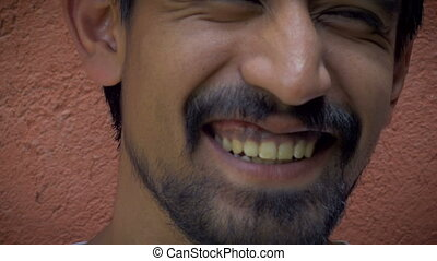 Extreme close up Portrait of a young handsome latino man...